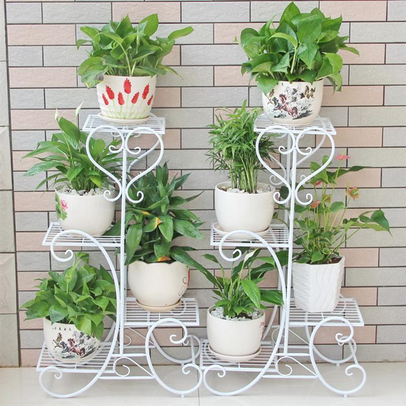 white wrought iron flower pots